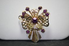 Vintage Gold Tone Purple Rhinestone Pin. Starting at $7 on Tophatter.com!http://tophatter.com/auctions/16295