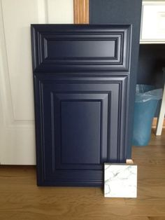 We ordered custom paint, so this is the painted sample that I have to approve. Then they can start building our real island cabinets. I love the door and . Navy Cabinets, Navy Blue Kitchen Cabinets, Painted Kitchen Island, Blue Kitchen Island, Narrow Kitchen, Kitchen Black, Kitchen Cupboards, Architecture Antique, Painting Kitchen Cabinets