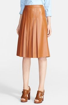 """Free shipping and returns on Michael Kors Pleated Plonge Leather Skirt at Nordstrom.com. <p><B STYLE=""""COLOR:#990000"""">Pre-order this style from the Pre-Fall 2014 collection! Limited quantities. Ships as soon as available. You'll be charged only when your item ships.</b></P><br>Supple plonge leather in a rich neutral hue elevates a gorgeous A-line skirt expertly shaped by dart-released pleats."""