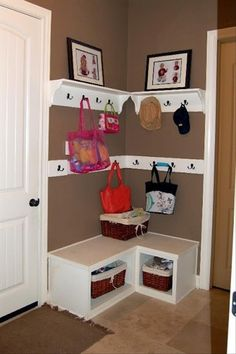 "Another pinner said: ""Cool idea for the corner by your front door.  Use a hook shelf with boxes that acts as bench and cube for storage."" I'm thinking something like this would work for the unused space in my garage near the door into the house."