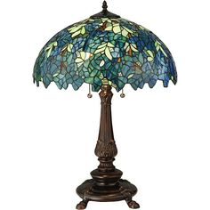 With its stunning Tiffany-inspired design, this Meyda table lamp makes a show-stopping addition to a desk or side table. Tiny stained-glass panes in shades of blue and green form an intricate pattern