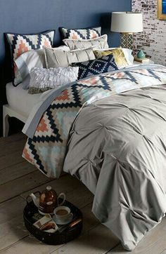 would be fun to add pops of mint or coral and black for sheets and pillowcases!
