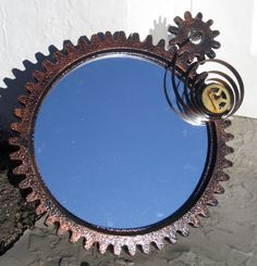 This Steampunk Cog Mirror was crafted By an Industrial Designer who finds Beauty in the machine. This version is one of a kind and features unique brass clock parts, additional cogs