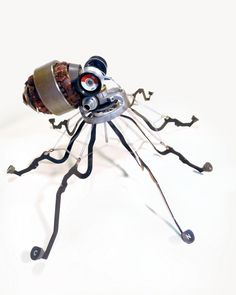 This is an octopus made from old typewriter parts, by Jeremy Mayer. He also makes people, cats, insects, penguins, birds, hands and more.