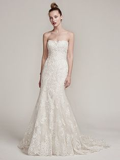 Sottero and Midgley - TESSA, Exquisite embroidered lace covers this sophisticated fit and flare wedding dress, embellished with Swarovski crystals and beads. Complete with an illusion sweetheart neckline and scalloped lace hemline flowing into an elegant train. Finished with crystal buttons over zipper and inner corset closure.