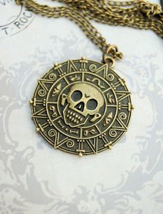 Pirates of the Caribbean coin jack sparrow necklace. I want all of the necklaces on this website!