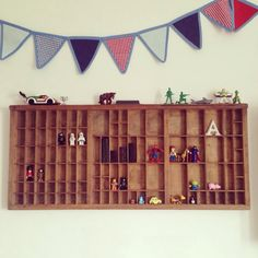 Old printers drawer with cute Lego men great idea to hang on wall