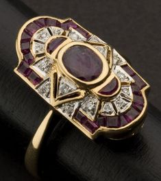 Superb Art Deco Diamond & Ruby Ring 18k yellow gold, 22 x 12 mm, center 7 x 5.5 mm oval ruby, 16 diamonds.