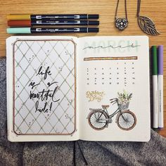 Bullet journal monthly cover page, March cover page, overlapping headers, bicycle drawing, flowers drawing, flowers in bicycle basket drawing. | @elzdoodles
