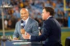 NBC Sports personalities Hines Ward and Bob Costas during an NBC Sunday Night Football broadcast between the Carolina Panthers abd the Pittsburgh Steelers at Bank of America Stadium on September 21, 2014 in Charlotte, North Carolina.