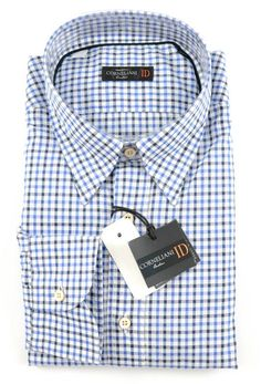 Small gingham in shades of blue makes this Corneliani shirt perfectly versatile.