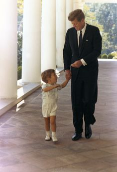 President Kennedy and his son, John F. Kennedy Jr. White House, West Wing Colonnade. October 10, 1963
