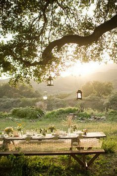Even a simple plank picnic table can be dressed up with a tablecloth and pretty dishes, and watching the sunset while dining would be a memory maker ~