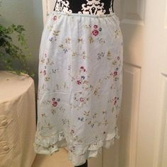 """Cute light blue floral print skirt. This is a light and comfortable skirt! Elastic waist and double ruffle with la e on the bottom. Lined. 22"""" long. Skirts"""