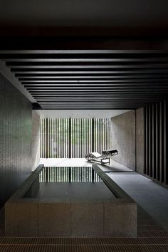 indoor pool. Reminiscent of an old Japanese onsen. Beautiful materials and textures. Great use of natural light and dark surfaces.