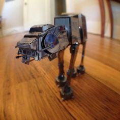 Here's a three-inch-hight AT-AT, built from one of the Fascinations laser-cut metal kits. Super fun, but make sure you have: patience, steady hands, a magnifying glass on a stand, an X-ACTO knife, and a sharp pair of needlenose pliers.