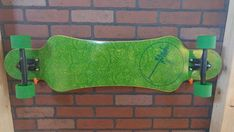 For sale is a walnut top with green pinstripes and paisley bottom custom, one off, handmade longboard by a professional longboard designer and builder. Dimensions are 10W x 39L x 9/16H. The board is made of 9 alternating layers of maple, berch, and bamboo with a top layer of Walnut. The