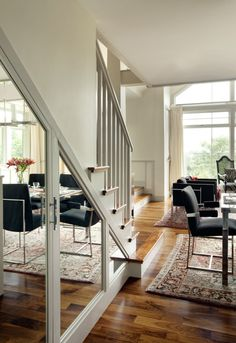 Mirrors on stairs to enlarge room
