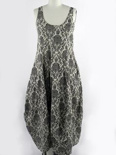 Hache. Love this dress. Wonder if would fit this old body.