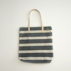 NORDDIK.COM  This bag has been created by using traditional cabana tents from the basque coast, from Zarautz. A hand-made piece of history crafted from last century's fabrics. After many summers exposed to the sun, this fabric obtains a variety of remarkable and singular tones making this bag unique and unrepeatable.