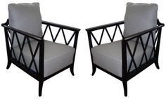 A pair of chairs with recently black-lacquered frames, newly reupholstered in light grey wool.   France, c.1940.   Total height (incl. cushion)- 88cm Frame height- 69cm Depth- 65cm Width- 75cm