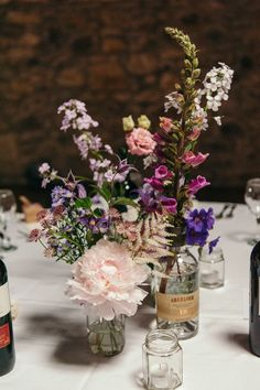 Centre pieces in whisky and gin bottles. Tables names after corresponding bottles. 16 tables and all our own bottles - we drink a lot of gin and whisky! @bluepoppypins