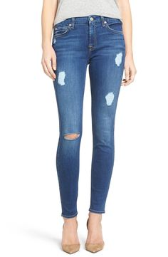 Cut from super-lightweight and incredibly soft denim that offers great stretch recovery, these skinny jeans are lightly distressed with allover fading.