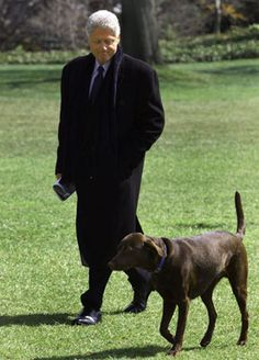 President Bill Clinton returns to White House in Washington with his dog Buddy, March 22, 1999.