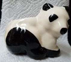 This is a lovely Panda Bear Planter. Black and white are the primary colors. 4 inches long, 3 3/4 inches wide and 3 1/2 inches tall. Opening is 2 3/4 inches in diameter.  Great for a kitchen window with herbs planted in it, miniature roses, or an accent piece on a table with fresh or silk flowers. Great for anyone who collects plants, animals, or items made in Japan.    To view other planters. vases in my shop, https://www.etsy.com/shop/DigginThruTheAttic?section_id=15989016 | Shop this…