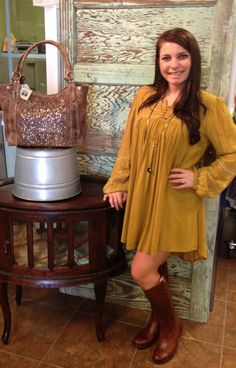 Any Georgia Southern fans out there? How cute is this game-day outfit? New Mustard Embroidered Dress, Serefina gold necklace, Frye Boots and Frye Handbag. Now available at Emma Laura-Graceful Gold located in Ivy Place 2032B Veterans Blvd. Dublin, GA 31021 478-272-2095 www.emmalaura.com Check us out on Facebook at https://www.facebook.com/pages/GRACEFUL-GOLD-JEWELRY-CO/163839008625