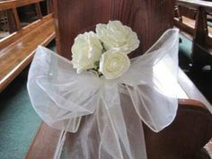 Ivory rose and organza bow pew ends