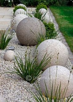 These cool and unique DIY Garden Globes are a bold statement for the modern garden room but can be softened with pretty intertwining flowers. Next Previous Cool and Unique DIY Garden Globes Back Gardens, Outdoor Gardens, Small Front Gardens, Garden Globes, Concrete Garden, Diy Concrete, Concrete Projects, Concrete Edging, Pebble Garden