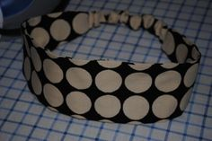 Here's how to make your own pattern for a reversible headband with a covered elastic back. Love it!