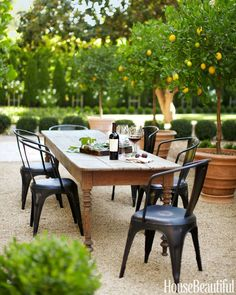 outdoor dining area in California | farmhouse table + industrial chairs