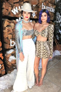 Kendall Jenner wearing a sequined bra top, matching cardigan, and wide-leg trousers at the Winter Bumbleland, and Kylie wearing a snakeskin two-piece set.