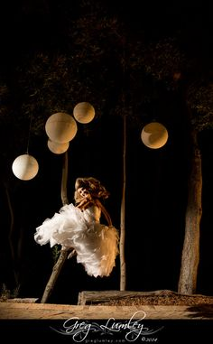 Bride jumping in air at night.  Wedding photos taken at night.  Night shoot by wedding photographer Greg Lumley.