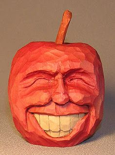 Here is a grinning apple. This was a chance to practice creating expressions. Pumpkin Face Carving, Pumpkin Faces, Wooden Pumpkins, Carved Pumpkins, Wood Carving For Beginners, Art Education Resources, Wood Carving Patterns, Halloween Clipart, Wooden Art