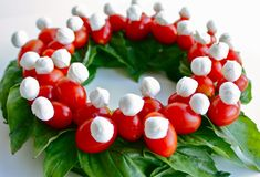 A Tomato Wreath ... easy as it looks spinach leaves, cherry tomatoes and mozzarella balls vinaigrette on the side toothpick ...