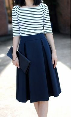 Womens modest vintage mid length skirts with a vintage pleated flare available in navy, red and black S-L.