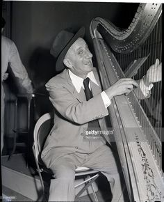Jimmy Durante, that imp of Broadway and Hollywood, went heavenly and plucked a harp at the command performance Christmas show for servicemen overseas. 'Ain't I a chord!' chuckleds Jimmy.