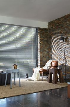Luxaflex® Wood Blinds reflect your style from elegant smaller wood slats sizes with extra privacy, to large slats that create an airy, more panoramic view for large windows. #Luxaflex #WoodBlinds #MidCenturyModern #ExposedBrick