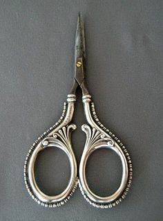 SIMONS FANCY STERLING EMBROIDERY / SEWING SCISSORS, with ornate repousse handles decorated the same on both sides  Both handles are marked with the Simons Bros. & Co shield logo, STERLING, 744T.