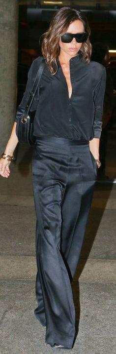 Who made  Victoria Beckham's black sunglasses, button down shirt, wide leg pants, sunglasses, and handbag?