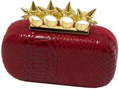 "Hearty Trendy Faux Snake Gold Spike Knuckle Ring Evening Purse Clutch Handbag Bag (Red) (red). Inside is lined with velvet black. Hinged brass-knuckle clasp with spikes 3.5"" x 2. Gold tone frame. Hard-shell design. Rounded corners."