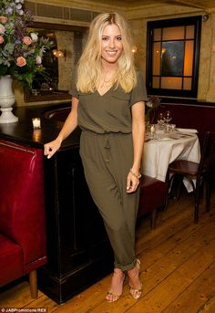 Mollie King showed off her style credentials in an Oasis jumpsuit at the brand's fashion launch in London on Wednesday