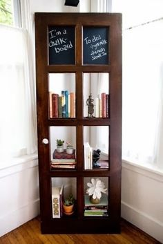 A door shelf with chalkboard paint applied to the top two panels.