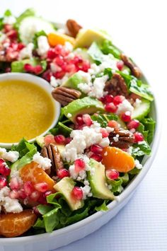 This Pomegranate Mandarin Salad with Avocado and Feta is a festive salad for any winter meal! It's bursting with fruit rich in Vitamin C, crunchy pecans and creamy avocado, and topped with crumbled feta or goat cheese. #holiday #wreath #salad