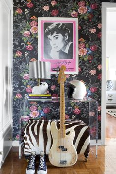 A bench and Lucite table paired with a bold floral wallpaper. Lonny, September 2013