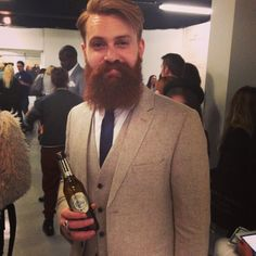 Ty Moorg looking dapper full thick dark red beard beards bearded man men suit tie ginger redhead warsteiner sharp-dressed