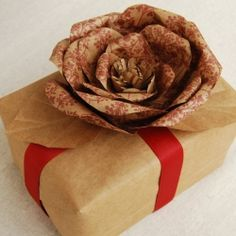 How to make a paper flower out of a grocery bag. This is a very green and thrifty paper project!